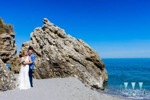 Nerja beach wedding photographer with the bride and groom