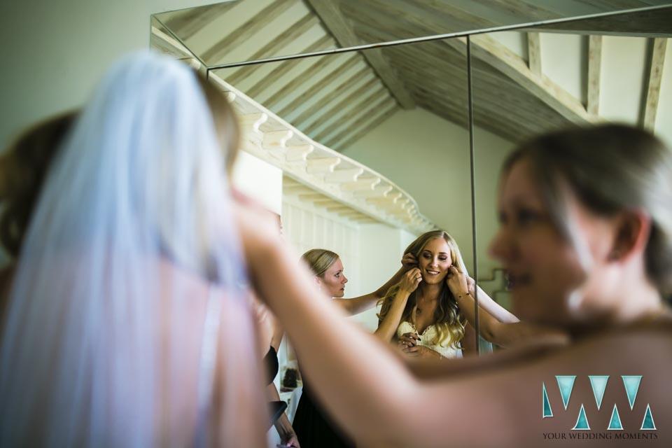 Villa Cisne wedding bridemaids helping bride